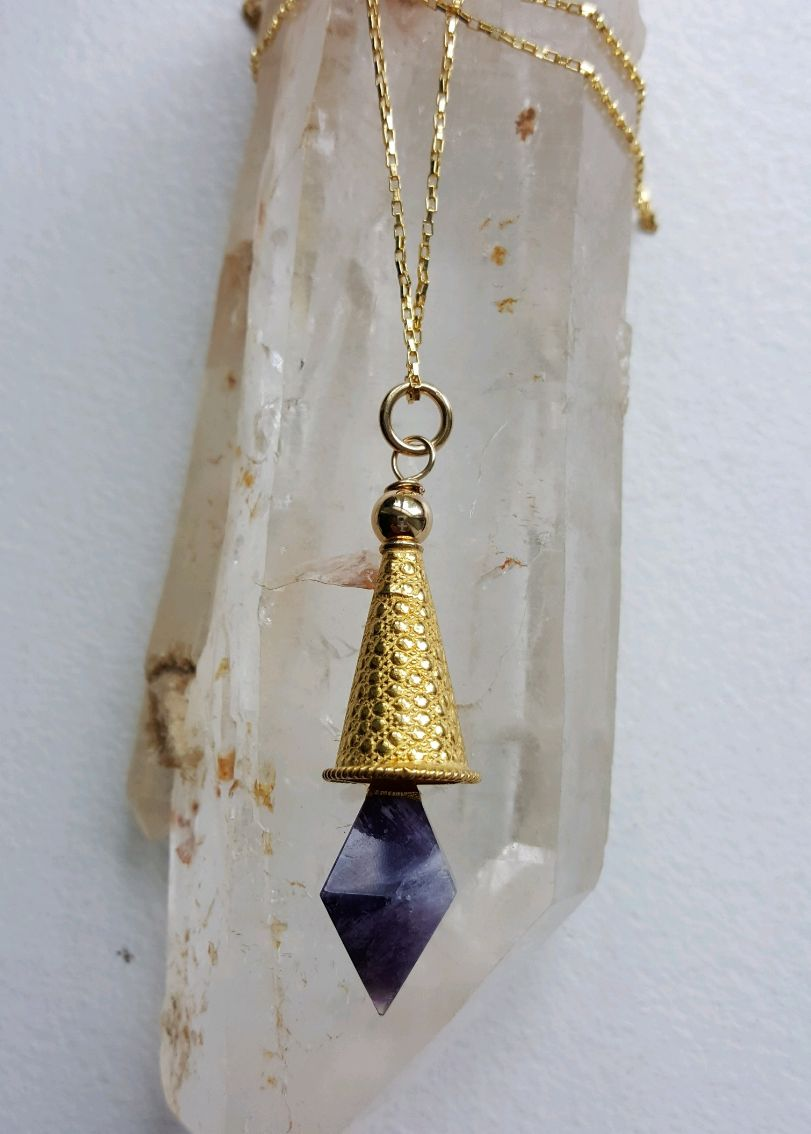 Amethyst point dangling from Gold Vermeil imprinted cone, on gold filled chain